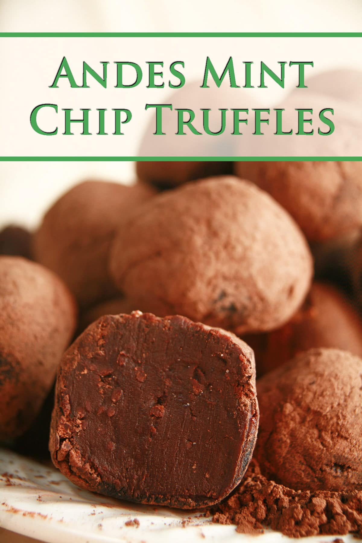 A small pile of Andes Mint Chip truffles rests atop a small mount of cocoa powder, on a small white plate.
