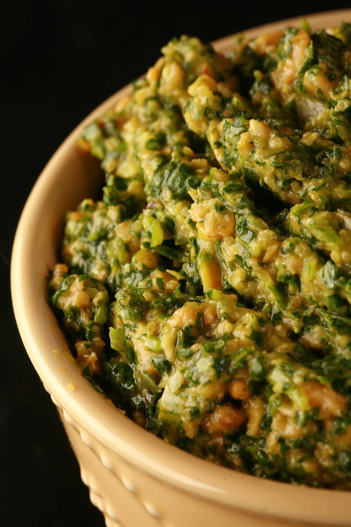 Close up view of a bowl of thai cilantro pesto.
