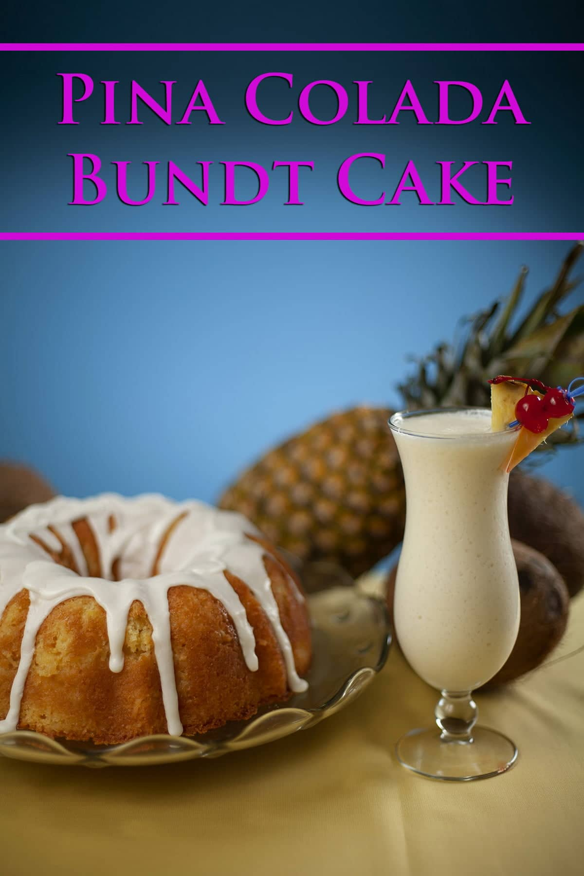 A pina colada bundt cake with white glaze dripping from the top is shown next to a tall tulip shaped glass of pina colada. A coconut and pineapple are in the background.