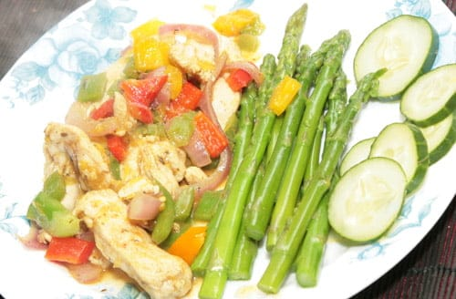 A low res image of a stir fry with asparagus