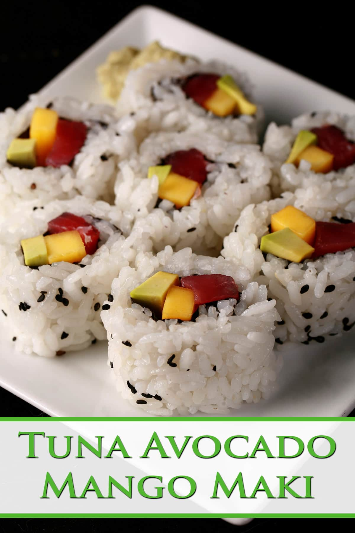 7 pieces of tuna avocado and mango maki roll slices, on a small white plate.
