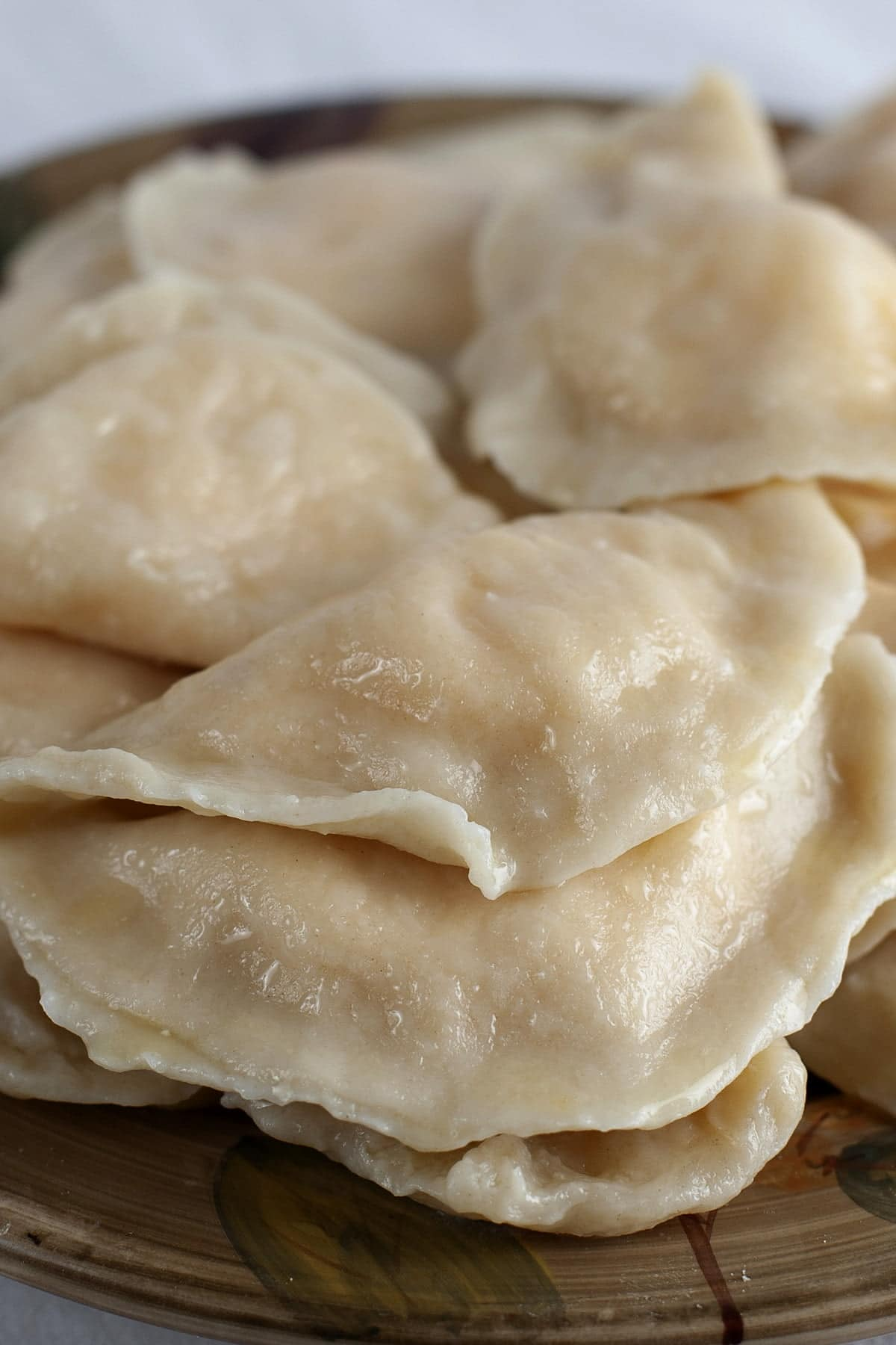A plate of homemade pierogi - Ukrainian dumplings filled with cheesy potatoes.
