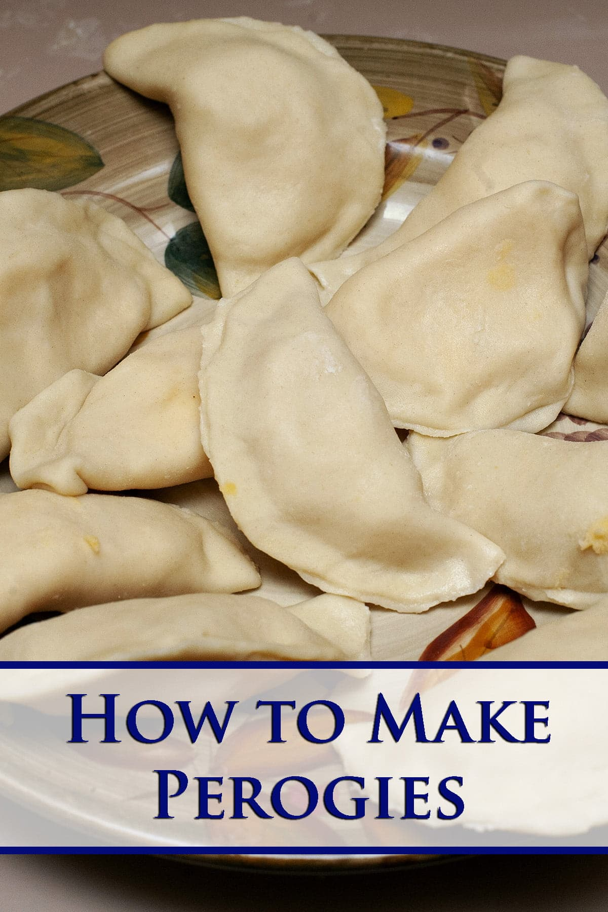 A plate of homemade pierogi - Ukrainian dumplings filled with cheesy potatoes. These are raw, ready to go in the pot of boiling water.