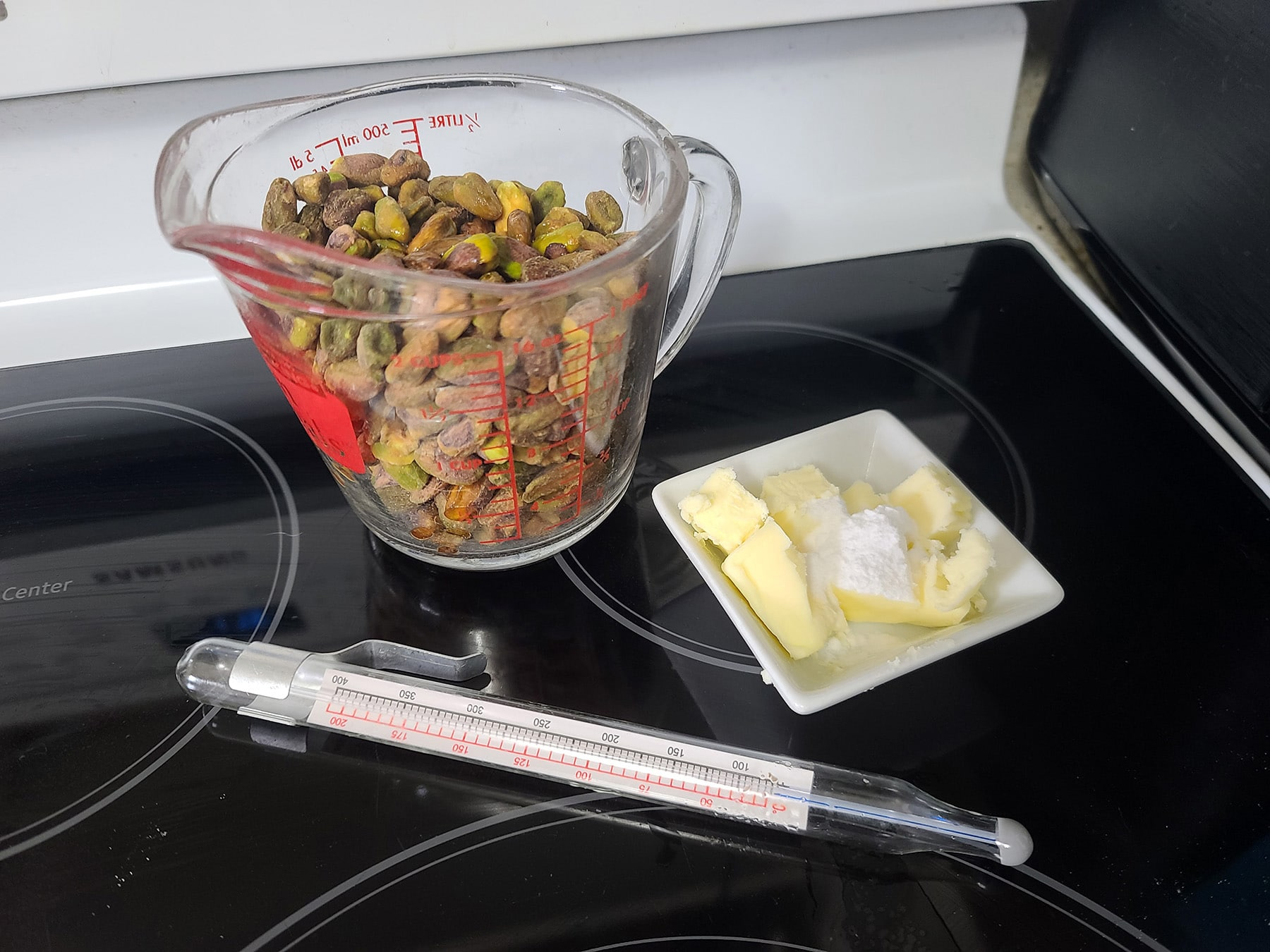 Pistachios, butter, baking soda, and a candy thermometer.