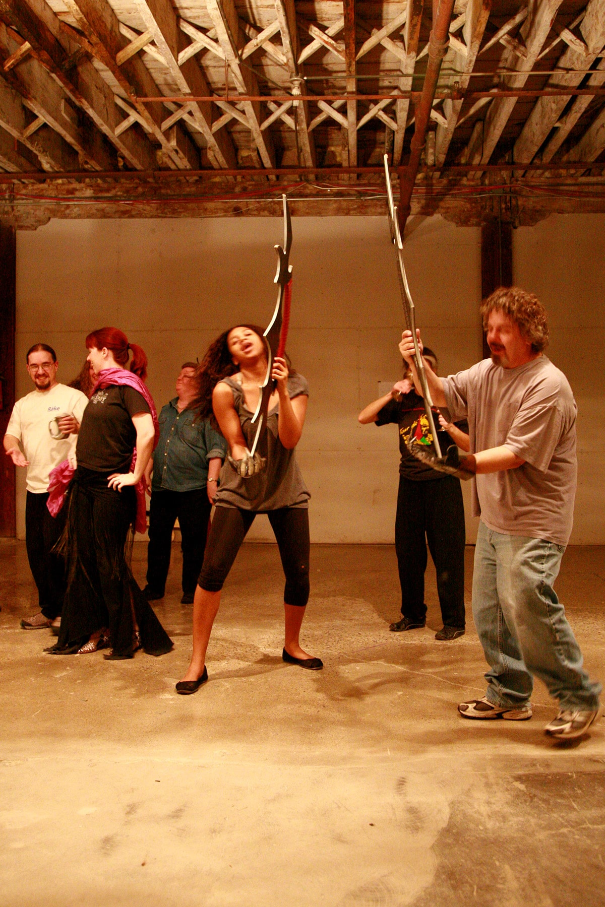 A group of actors practicing with Bat'leths.