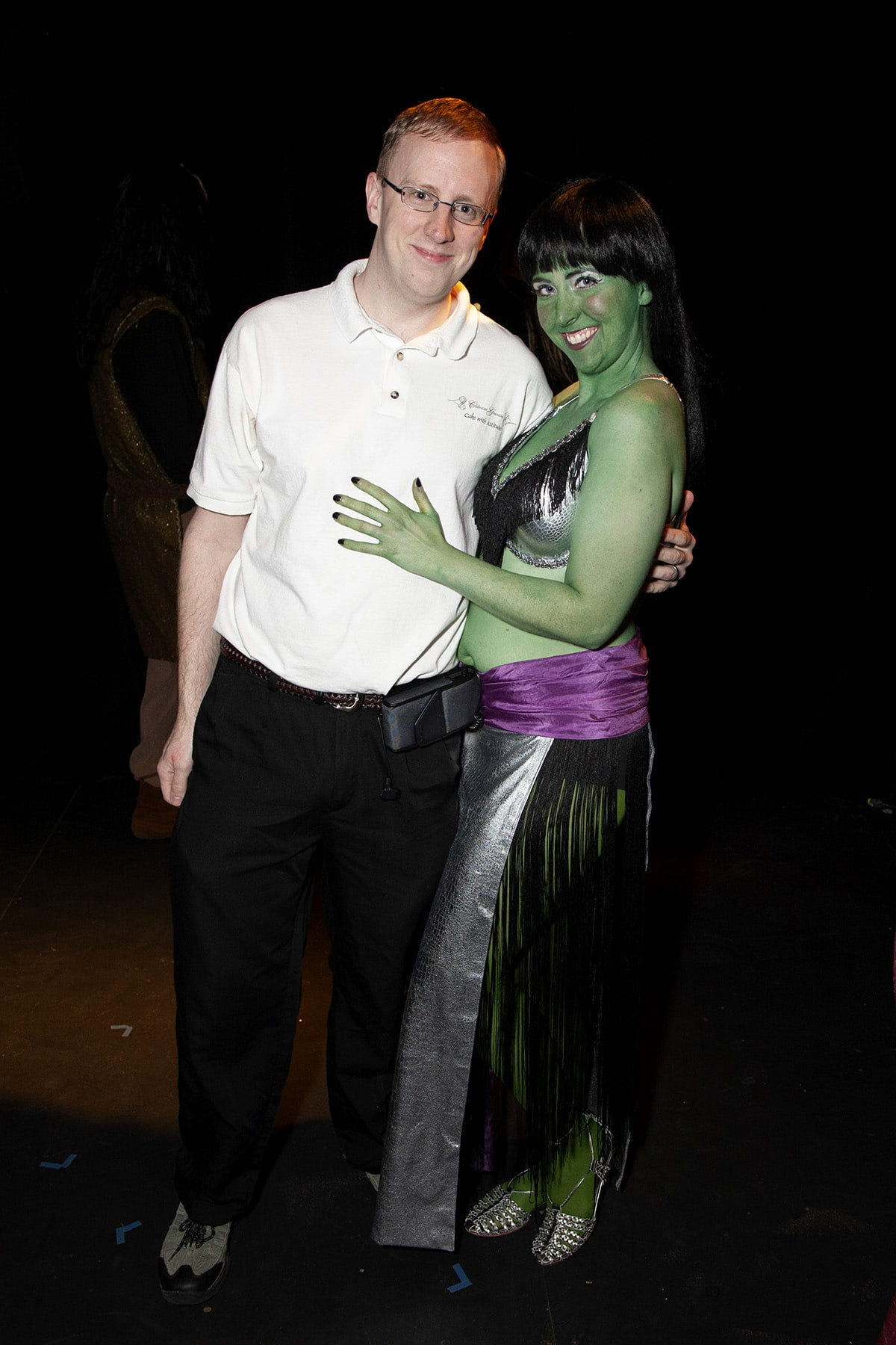 The author's husband poses with a green-skinned Orion Dancer.