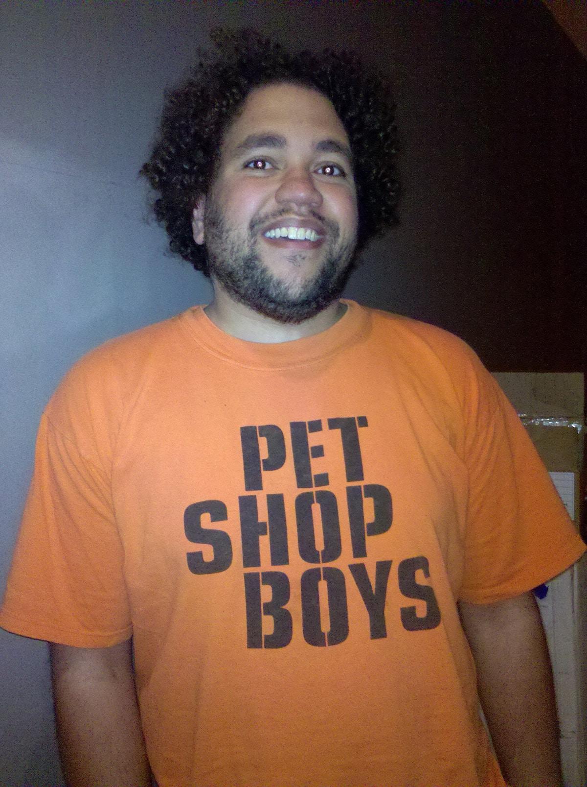 Duck Washington, wearing an orange Pet Shop Boys shirt.