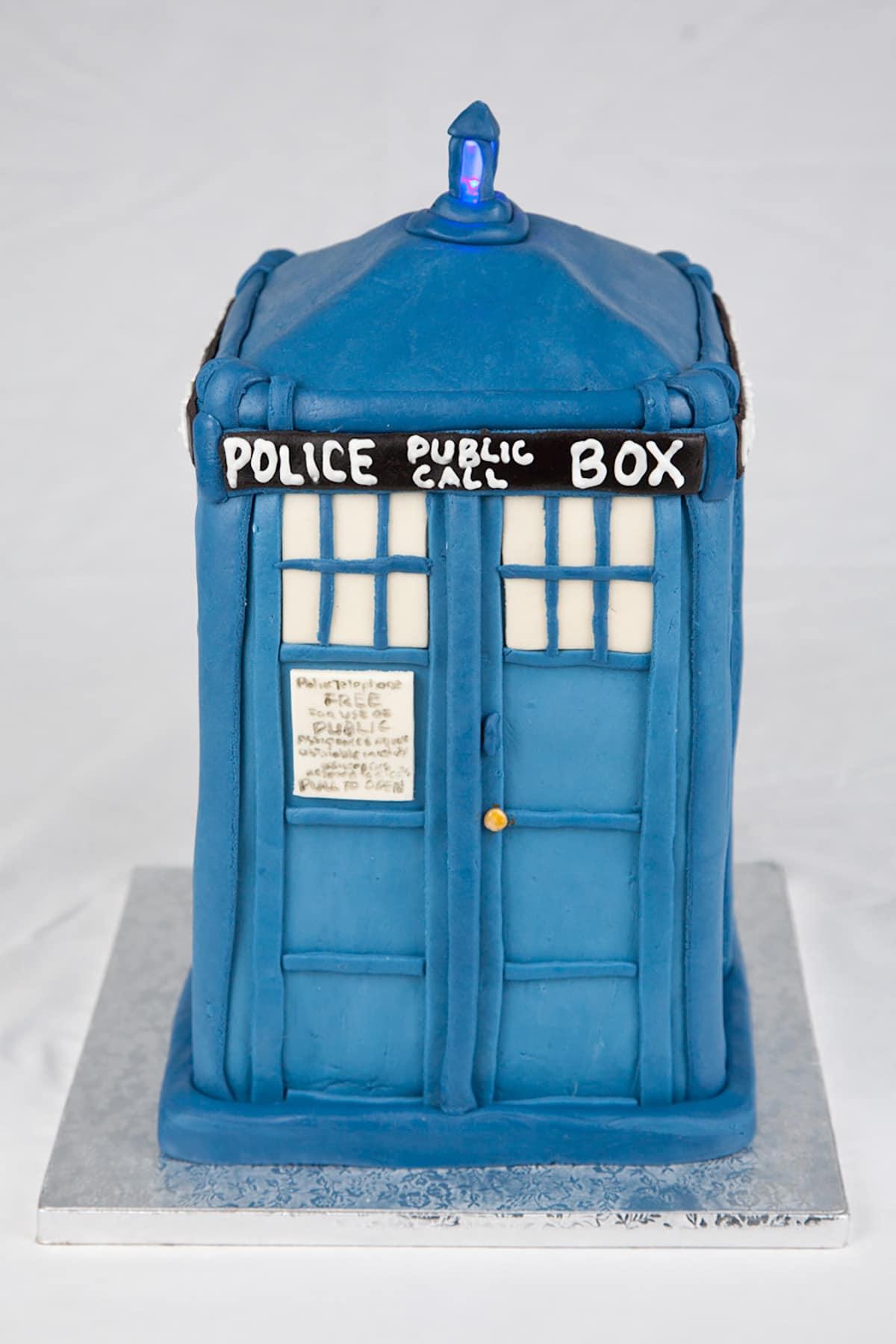 The TARDIS cake, with the top light lit.