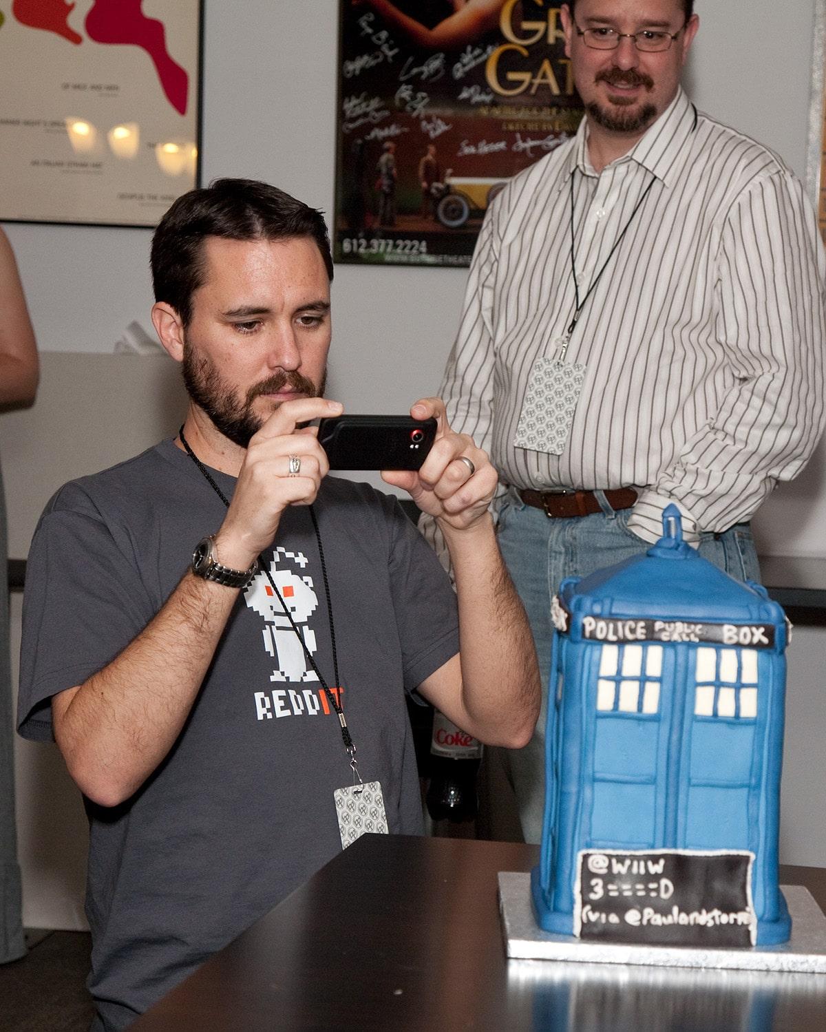 Wil Wheton taking a photo of a TARDIS Cake