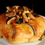 Brie en Croute with Prosciutto, Honey Pear Sauce, Figs, and Pistachios