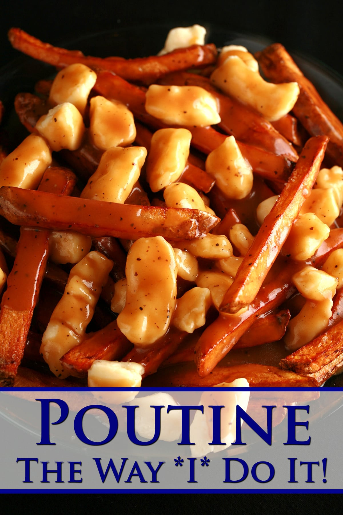 A plate of poutine - fries, white cheese curds, and gravy.