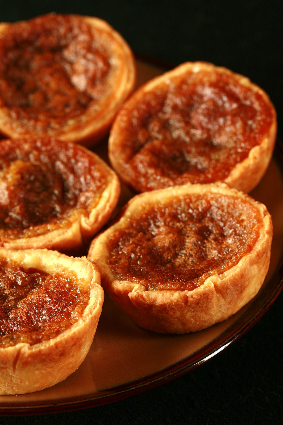A plate of maple buttertarts.