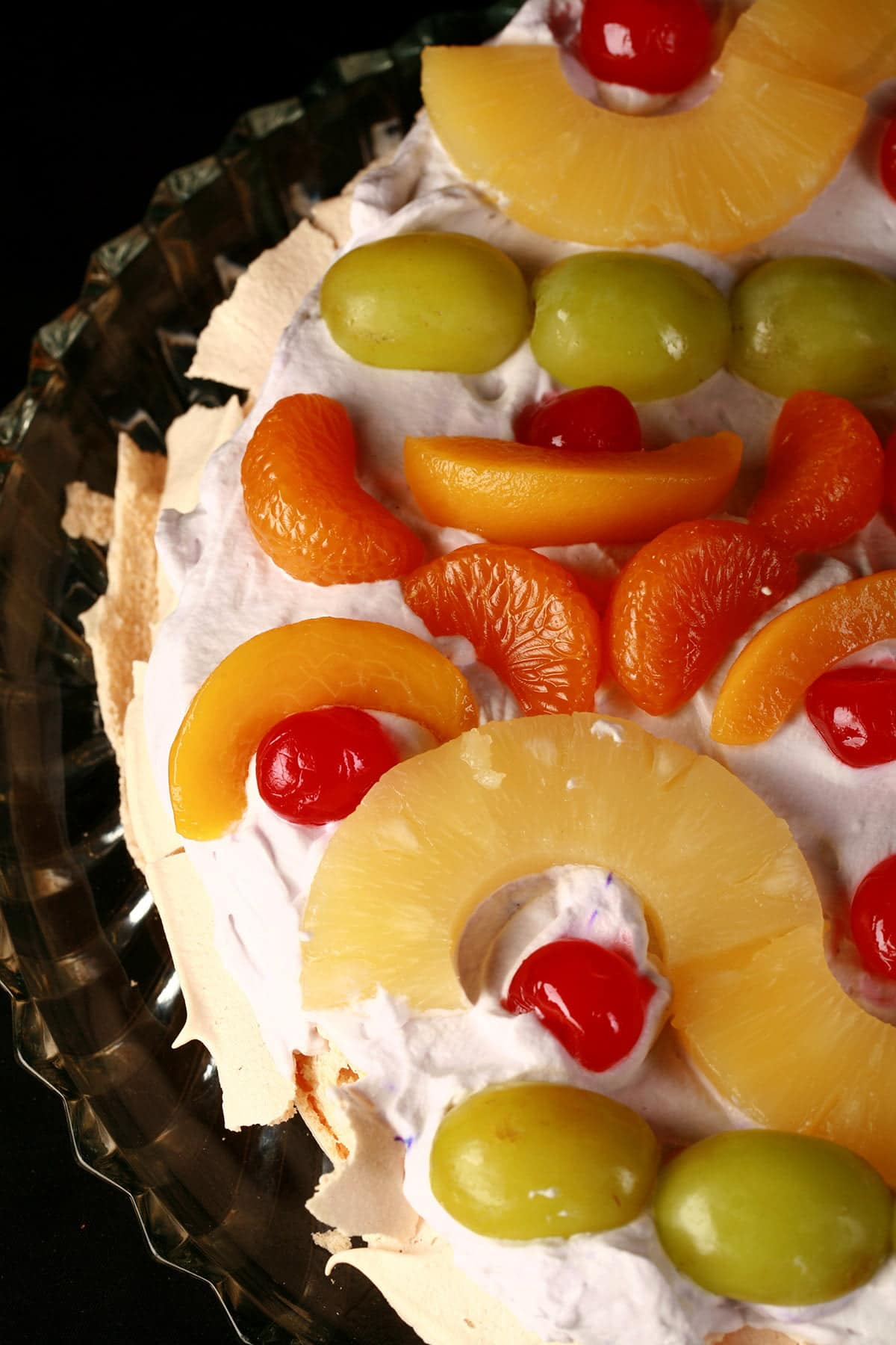 A close up view of an Easter Egg themed pavlova.