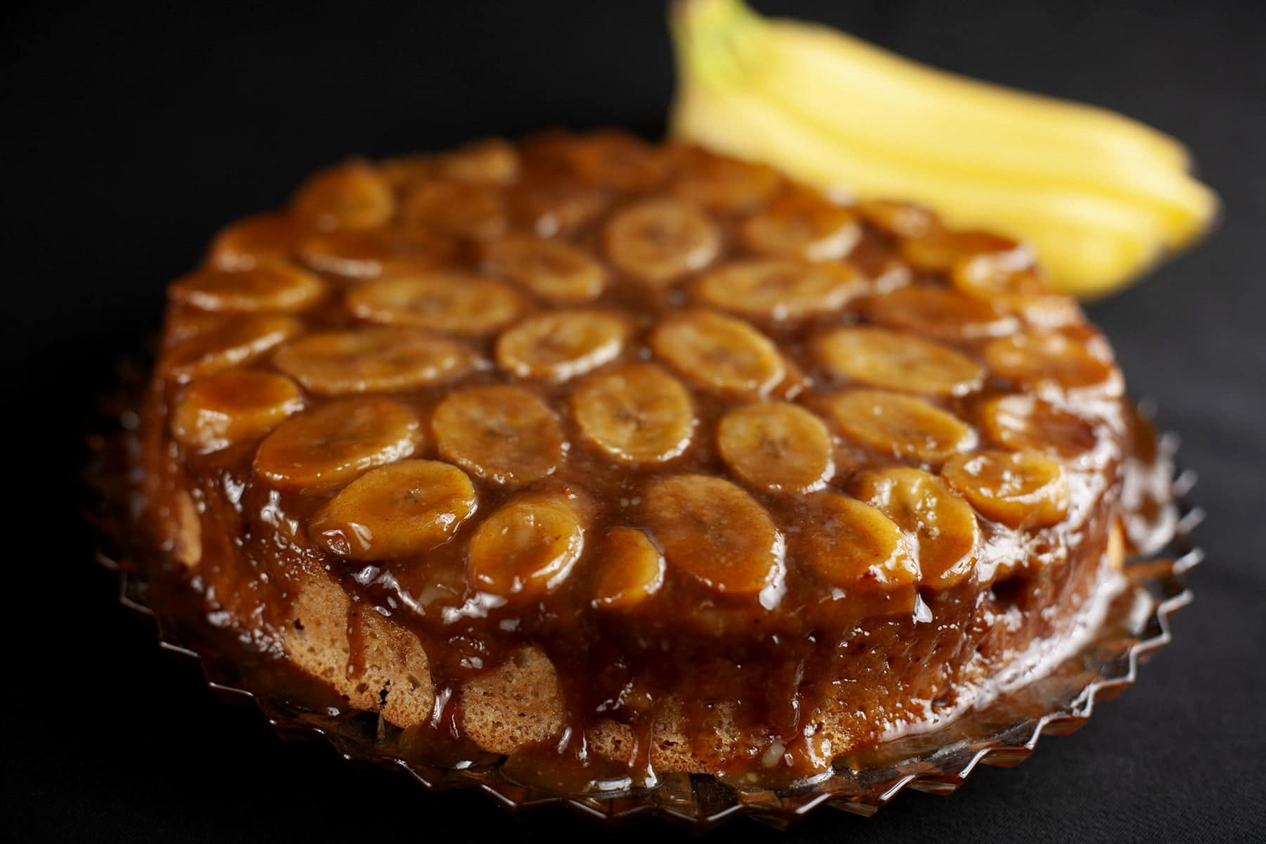 A bananas foster upside down cake: A large round cinnamon rum cake, topped with bananas and a cinnamon rum caramel... upside-down cake style.