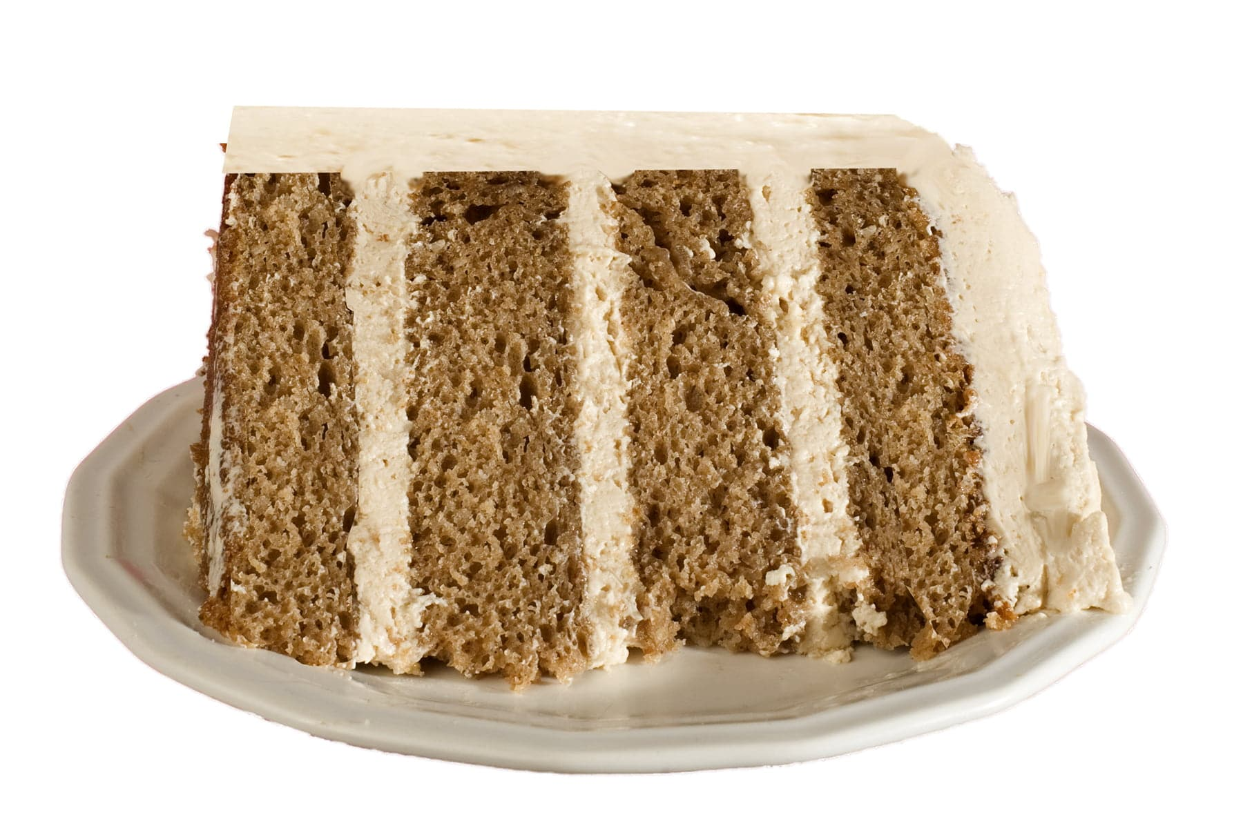 A slice of chai spice cake - a 4 layer spice cake with layers of chai buttercream.