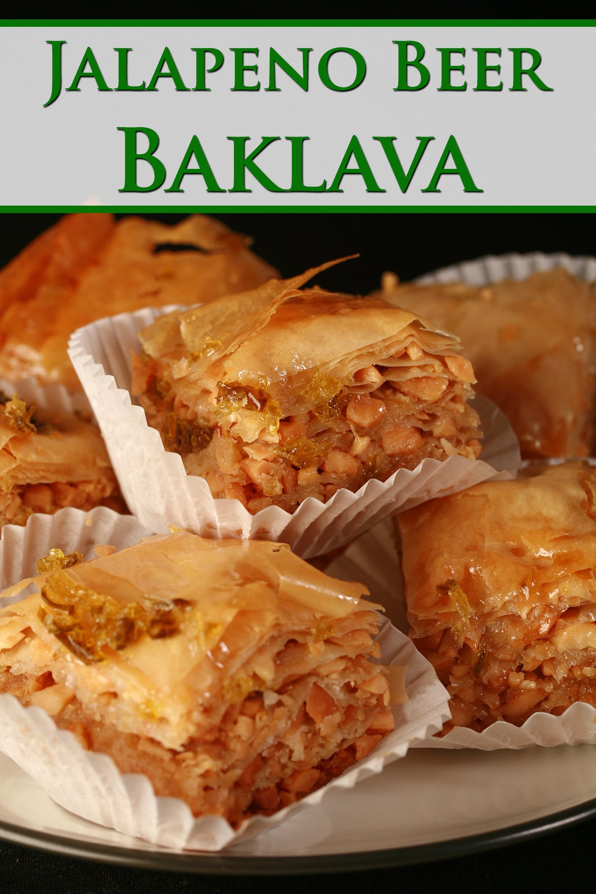 A small stack of squares of jalapeno beer peanut baklava, on a small plate.