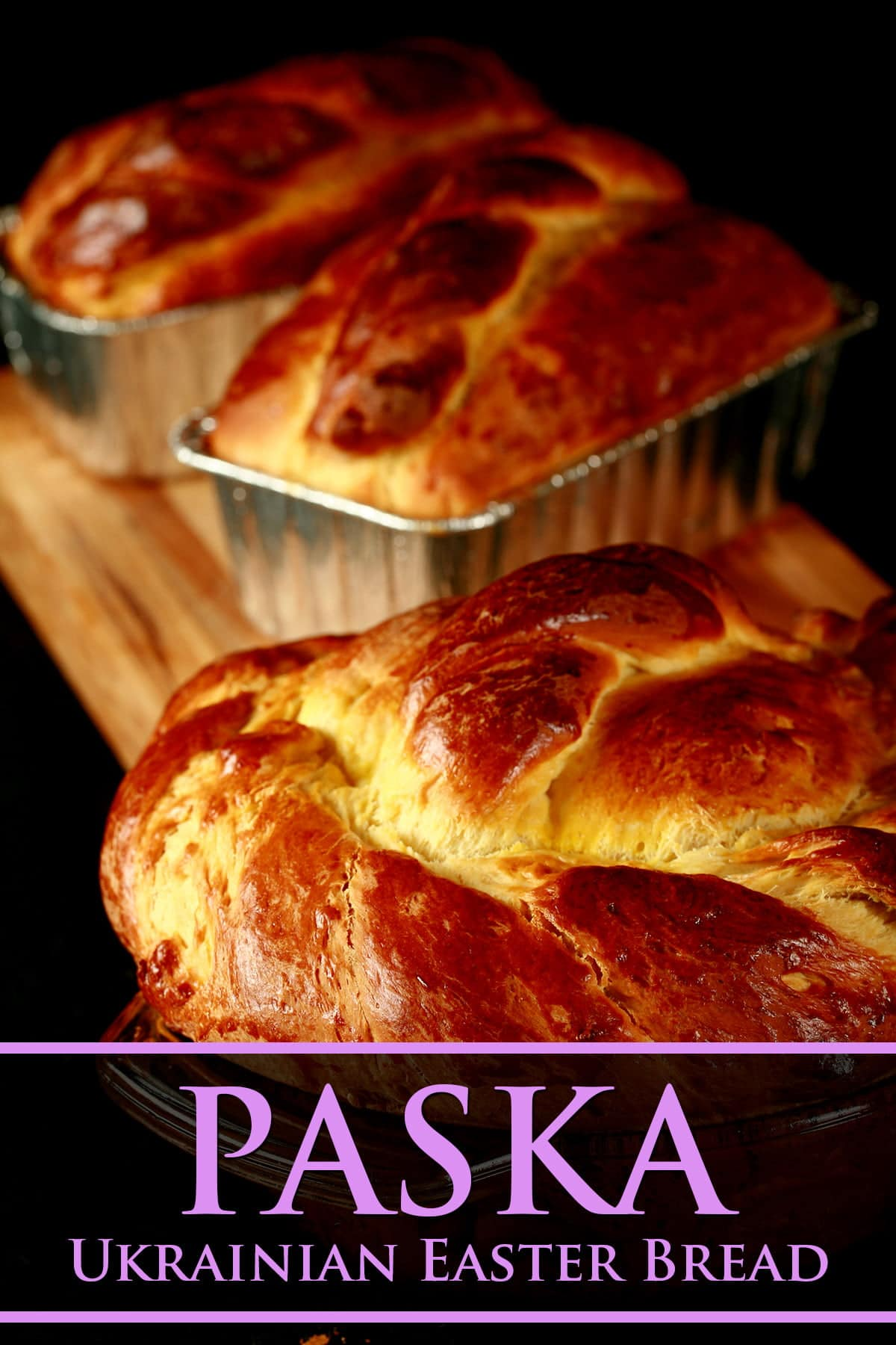 3 loaves of braided and twisted Paska - a Ukrainian Easter bread - on a black background.