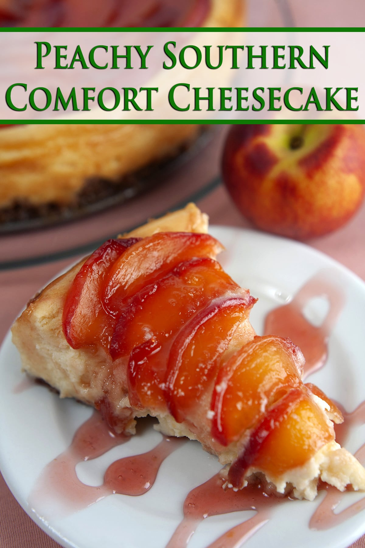 A slice of peach cheesecake with a pink drizzle, next to the whole cheesecake, and a fresh peach. Green text says Peachy Southern Comfort Cheesecake.