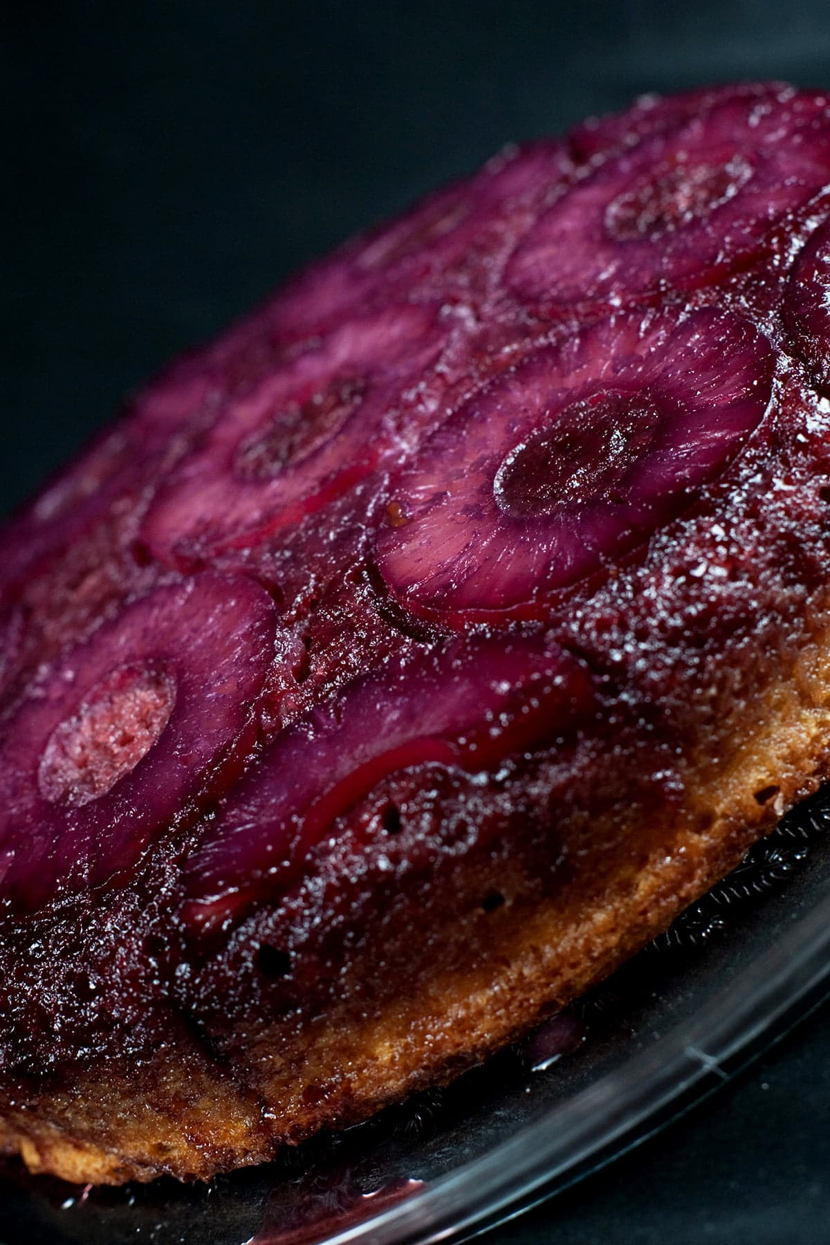 French Martini Upside Down Cake - A round pineapple upside down cake, with a VERY purple top.