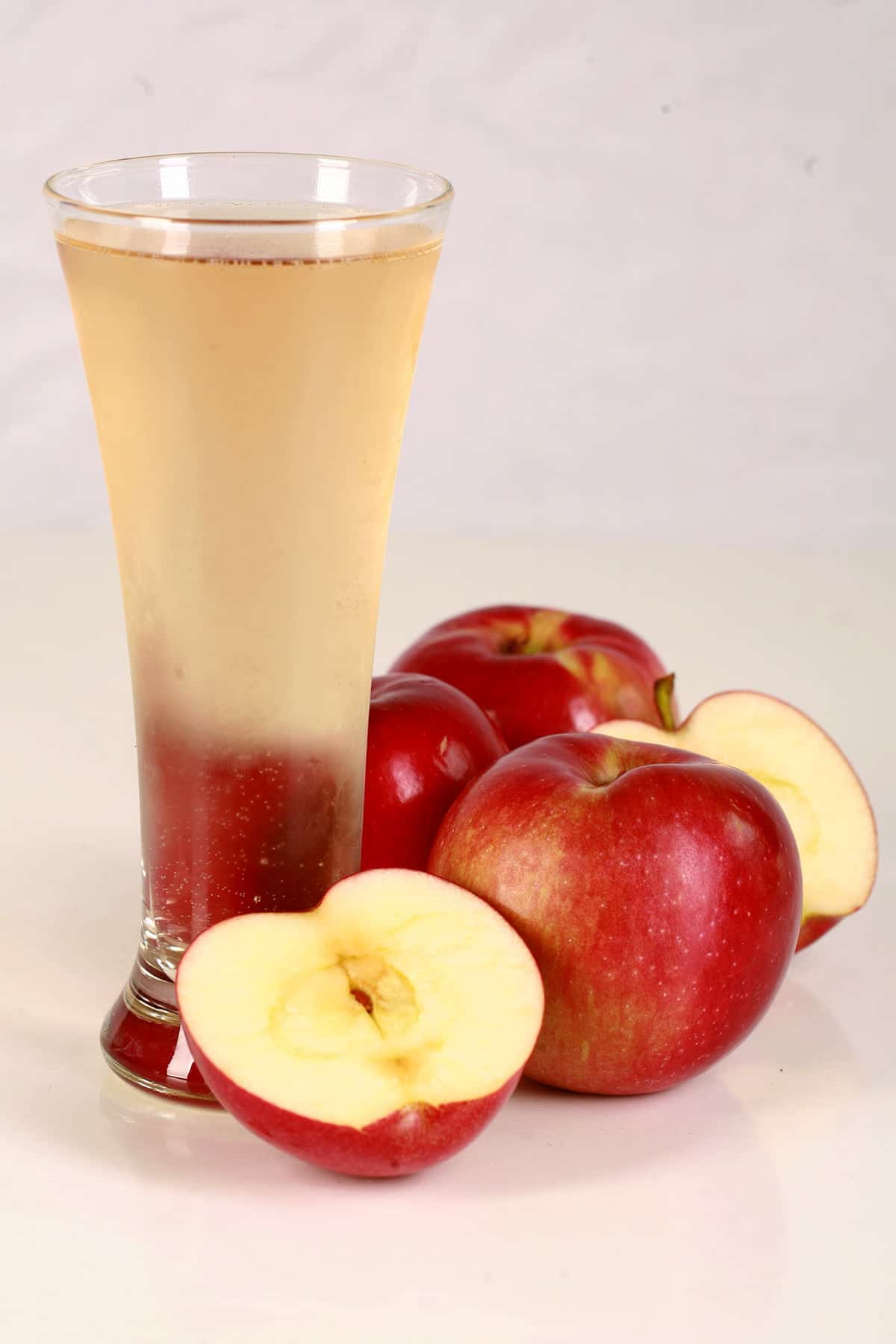 A glass of home brewed hard apple cider, made using this hard apple cider recipe.