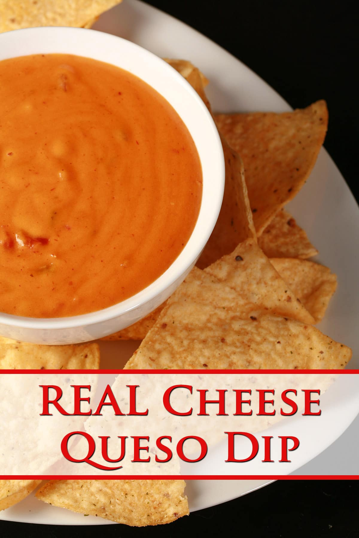 A bowl of real cheese queso dip, surrounded by tortilla chips.