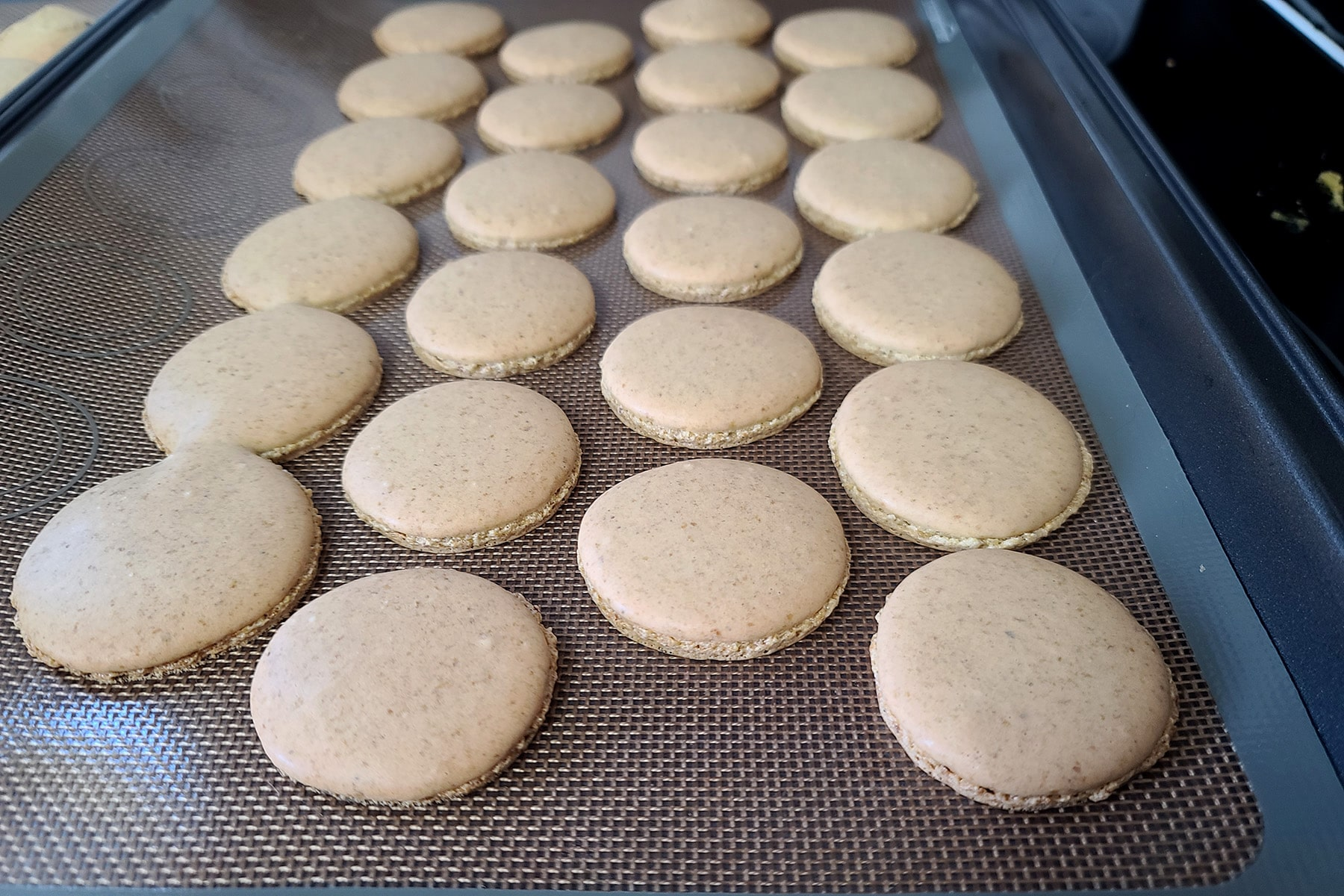 A pan of perfect looking macarons.
