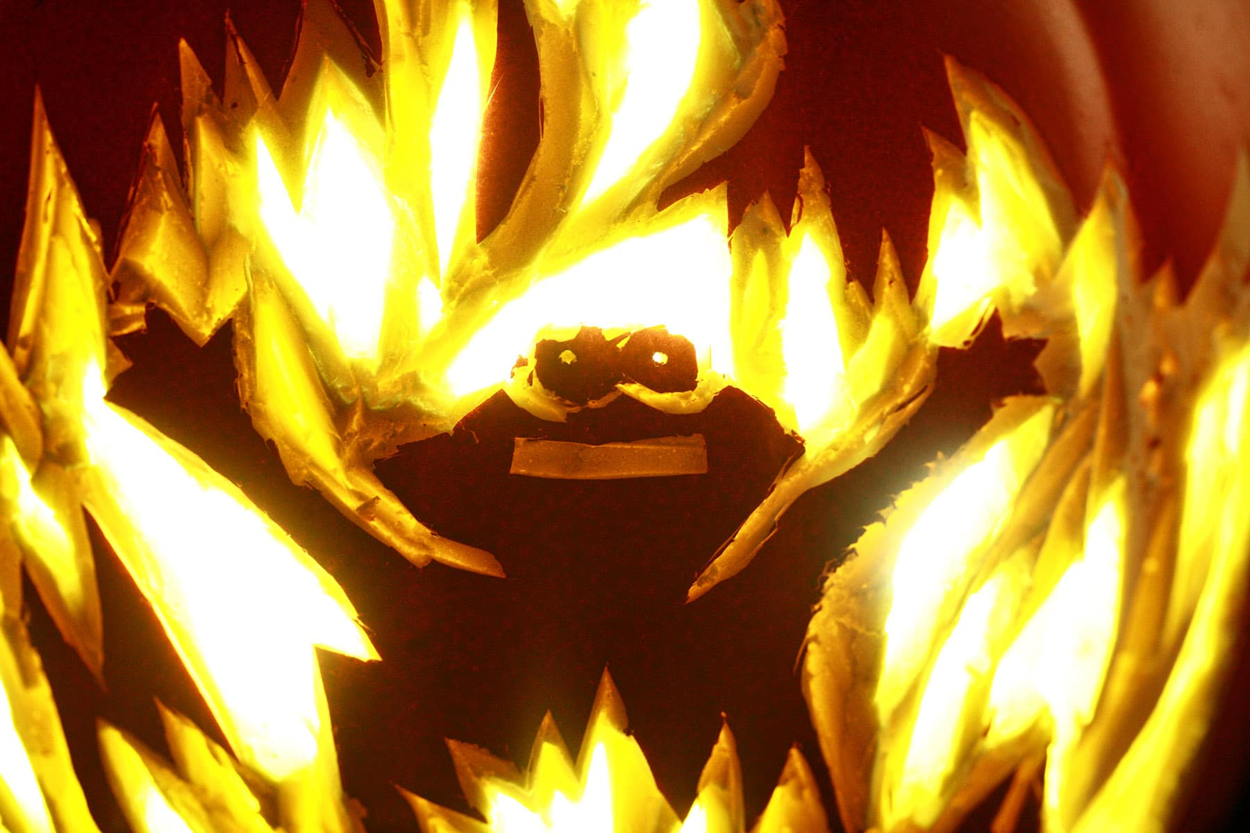 A close up view of a foam pumpkin shaved to look like Elmo in fire.