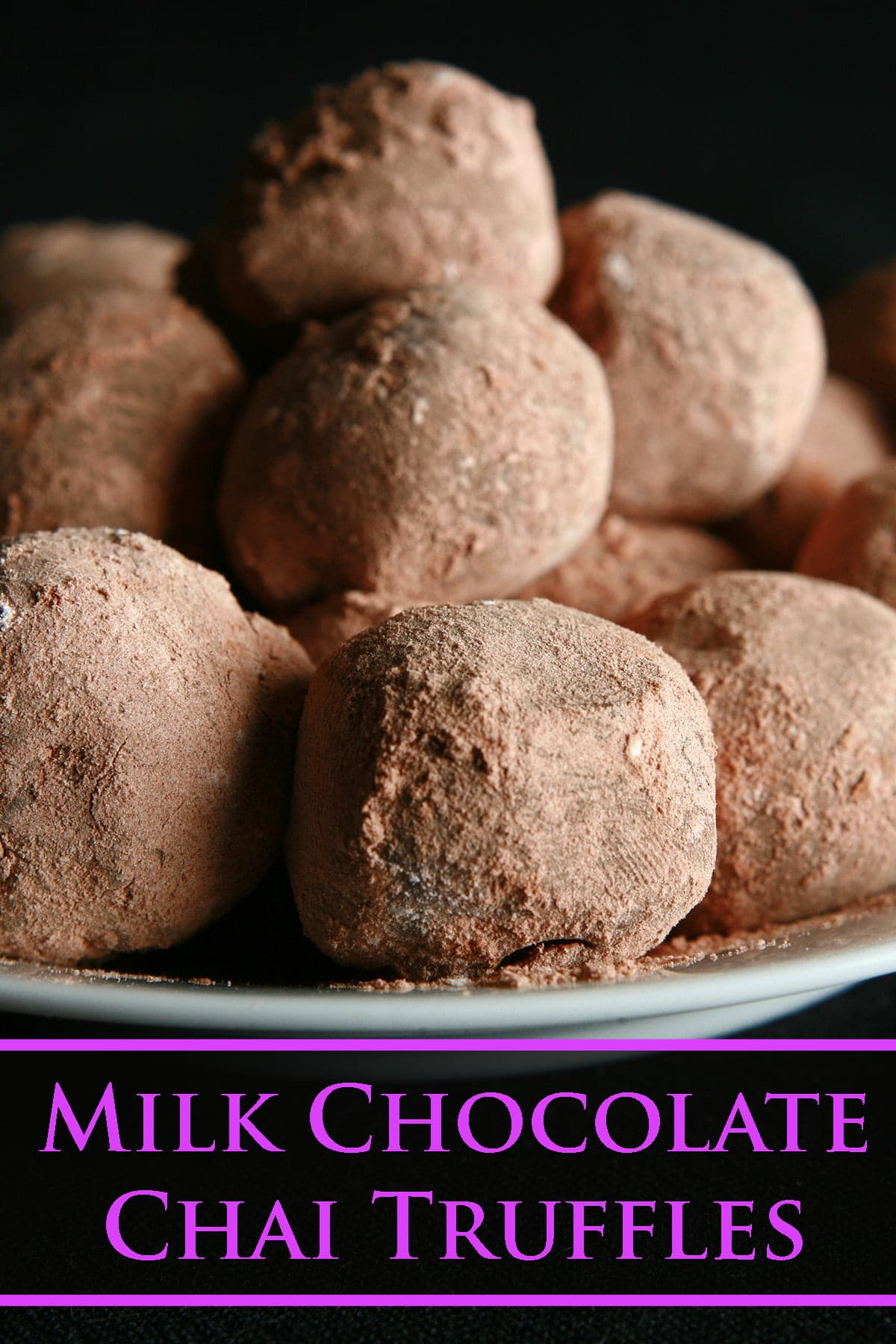 A small plate with a pile of cocoa-coated milk chocolate chai truffles.