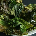 A bowl of deep green kale chips.