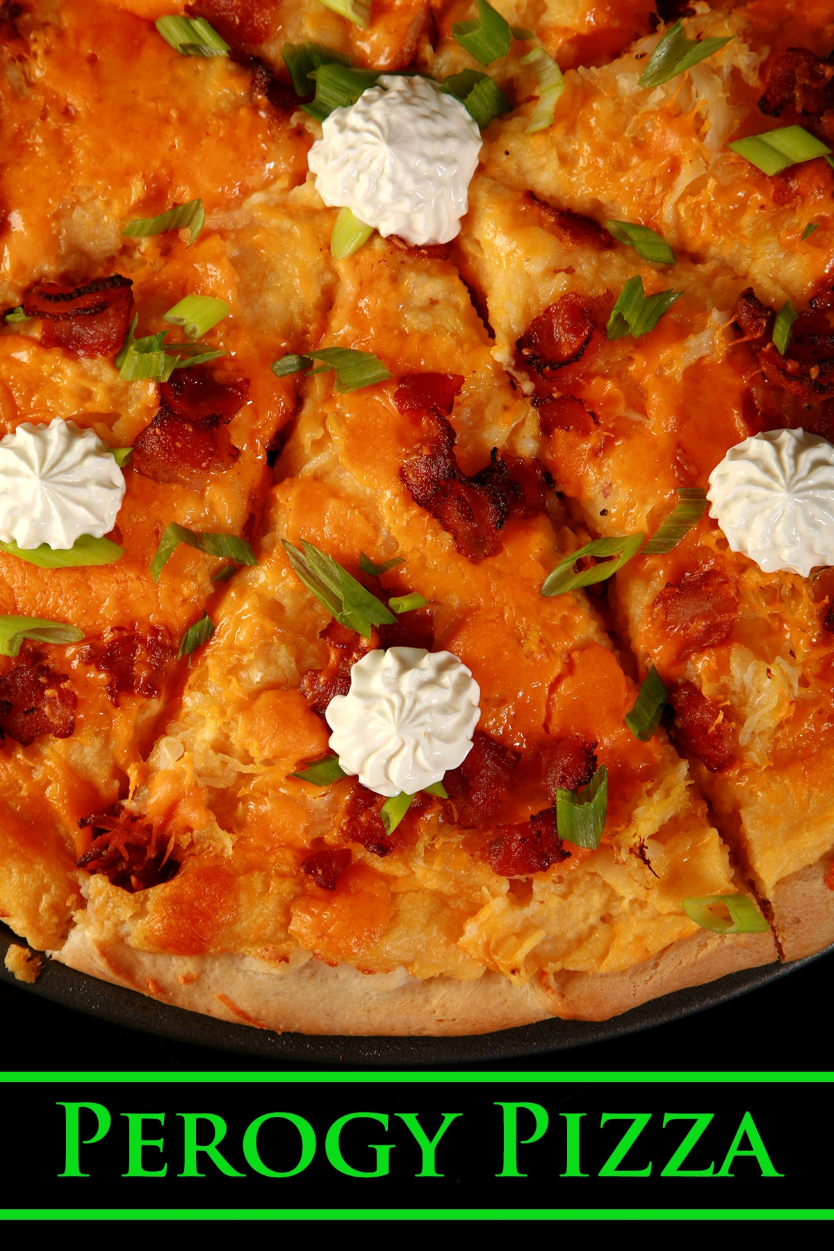 A whole Perogy Pizza - bacon, green onions, cheddar cheese, cheesy potatoes, and sour cream!