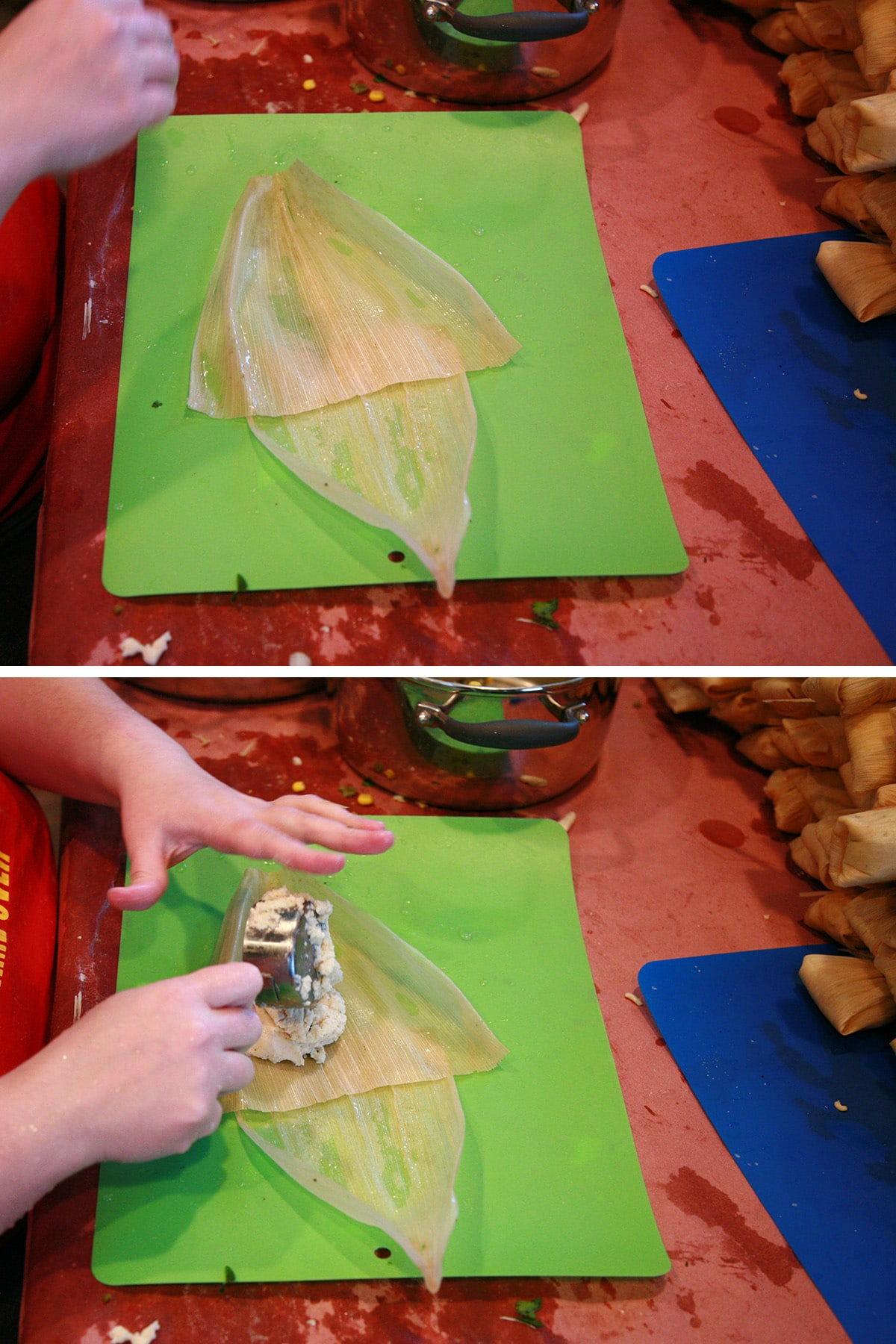 Two corn husks are laid out, dough scooped out onto the bigger one.