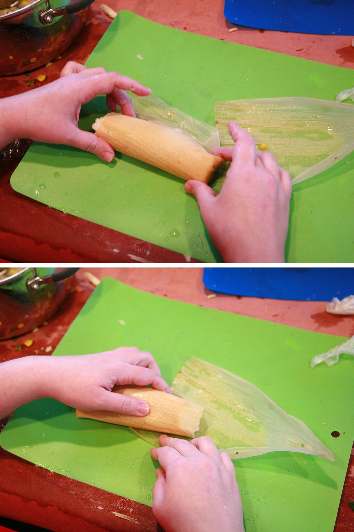 Two hands roll the tamale, as described.