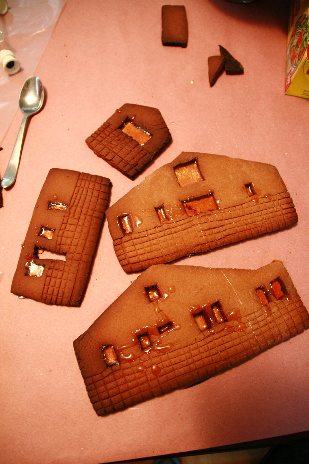 Pieces of an undecorated gingerbread house.
