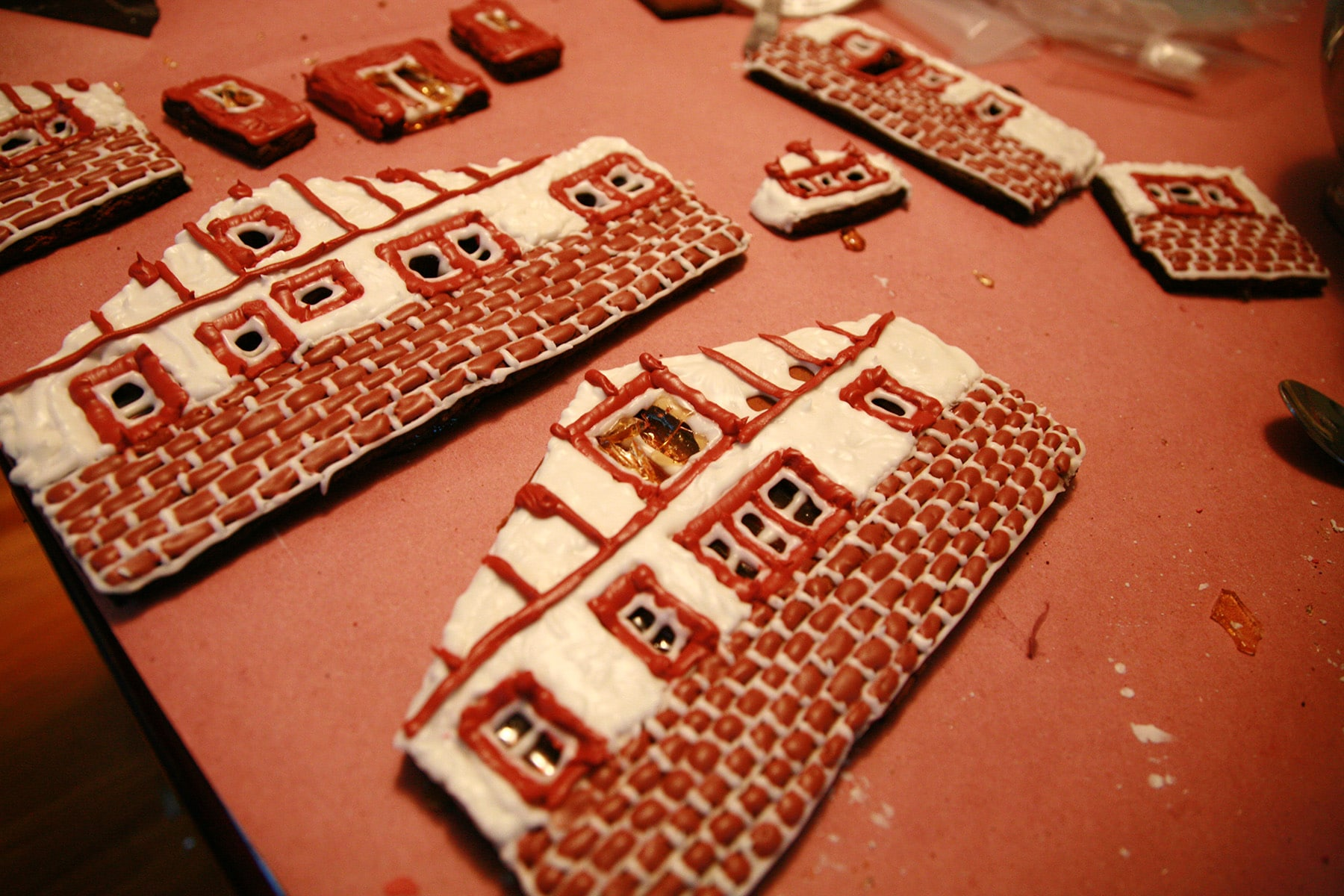 The walls of a gingerbread house, decorated with icing bricks and stucco.