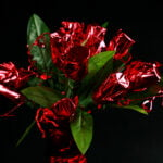 A bouquet made of mini liquor bottles. Each is wrapped in red mylar to look like a rose.