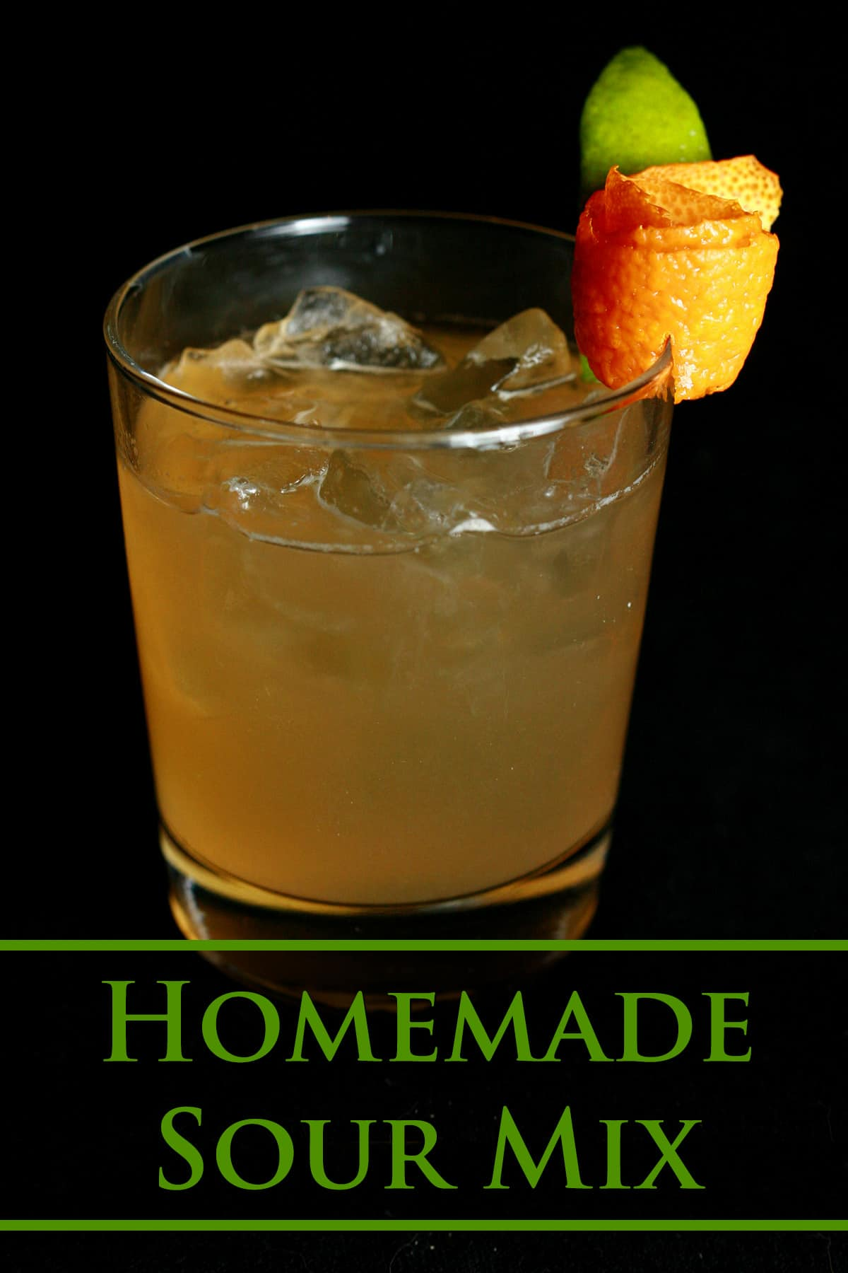 A small amaretto sour cocktail. Green text overlay says homemade sour mix.