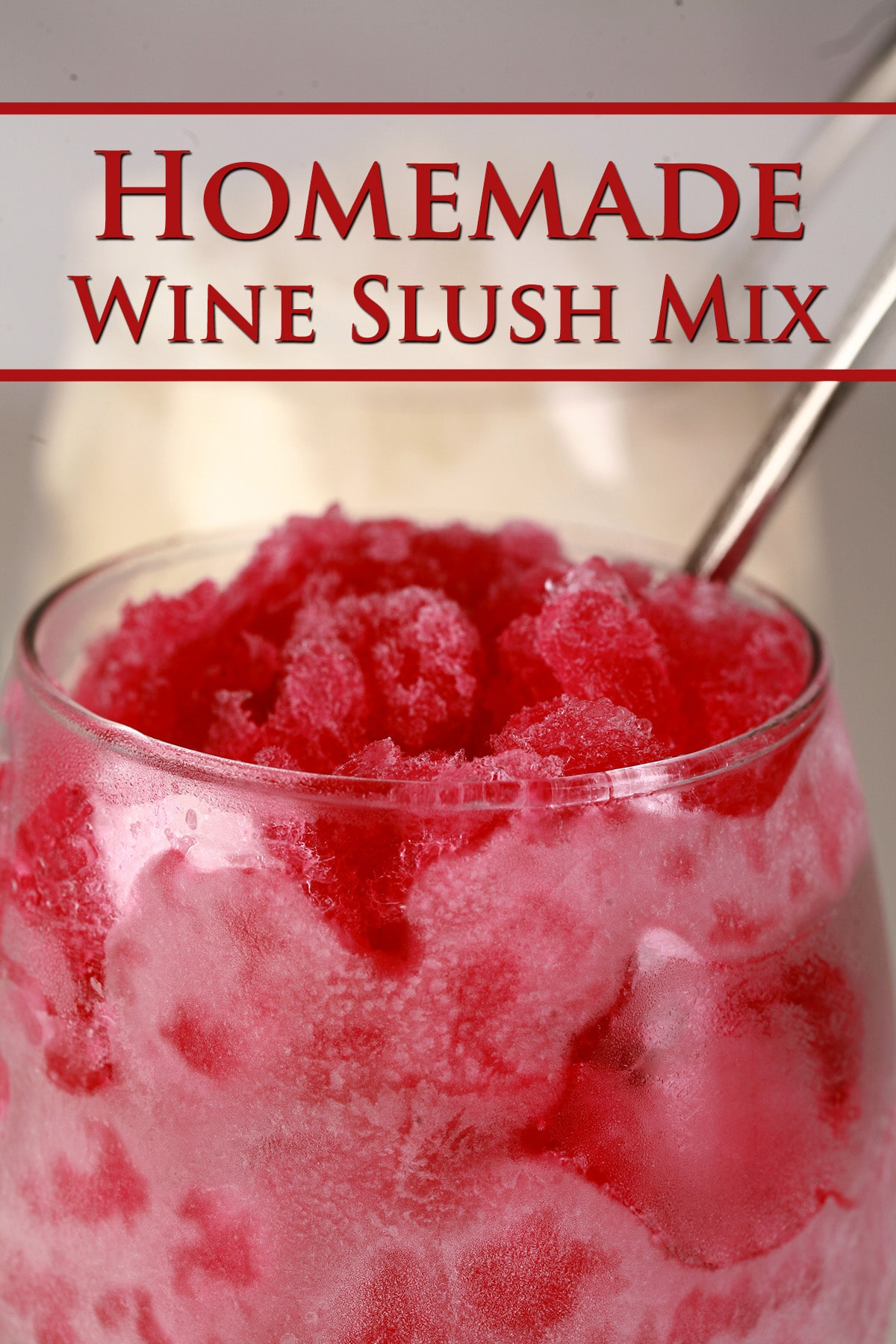 Two frosty wine glasses with wine slush in them - one is made with red wine, the other with white. Red text overlay says Homemade Wine Slush Mix.