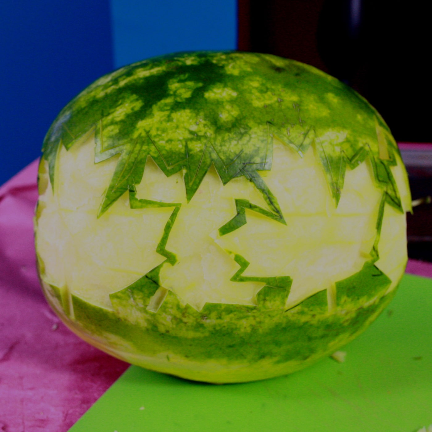 A border of several white maple leaves have been carved into the watermelon.