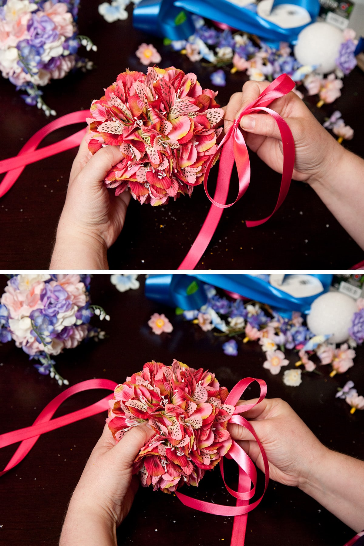 Two hands pin the ribbon to the base of the pomander.