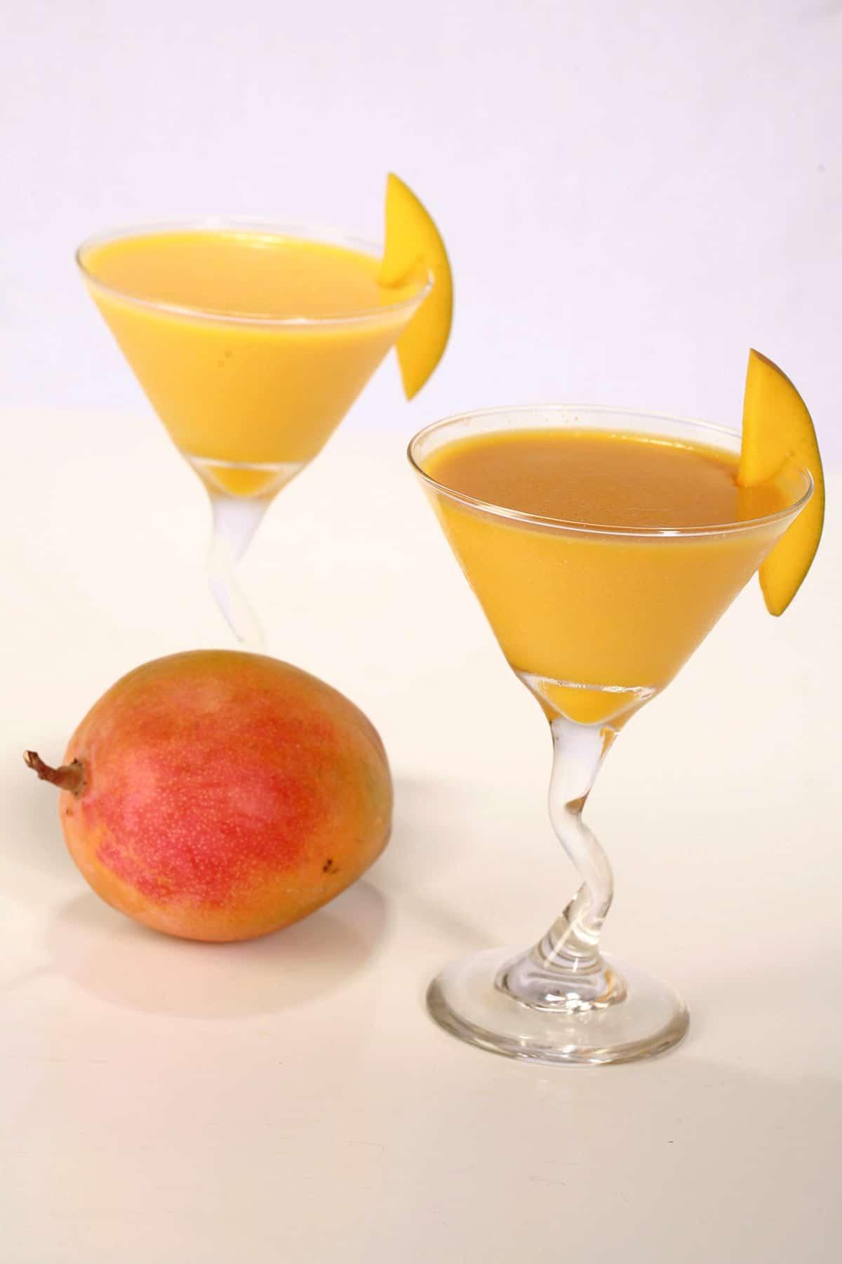 2 mango panna cottas in martini glasses.