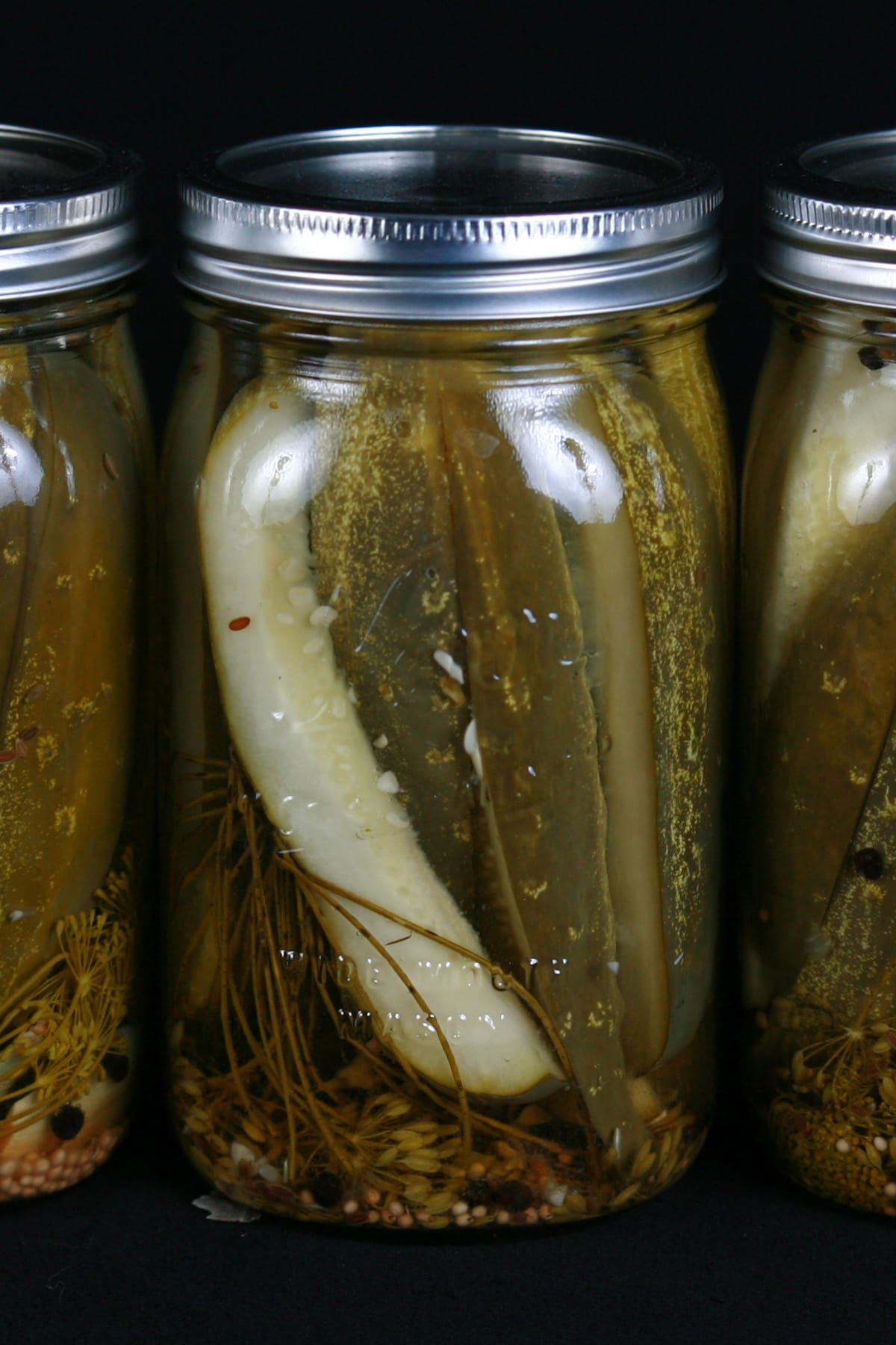 3 large jars of homemade dill pickles.
