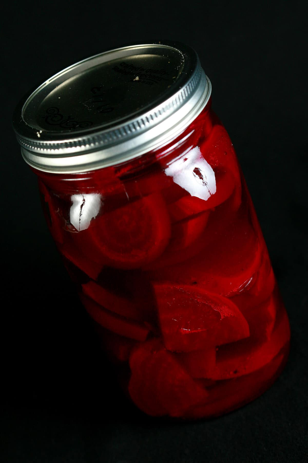 A large jar of homemade pickled beets.