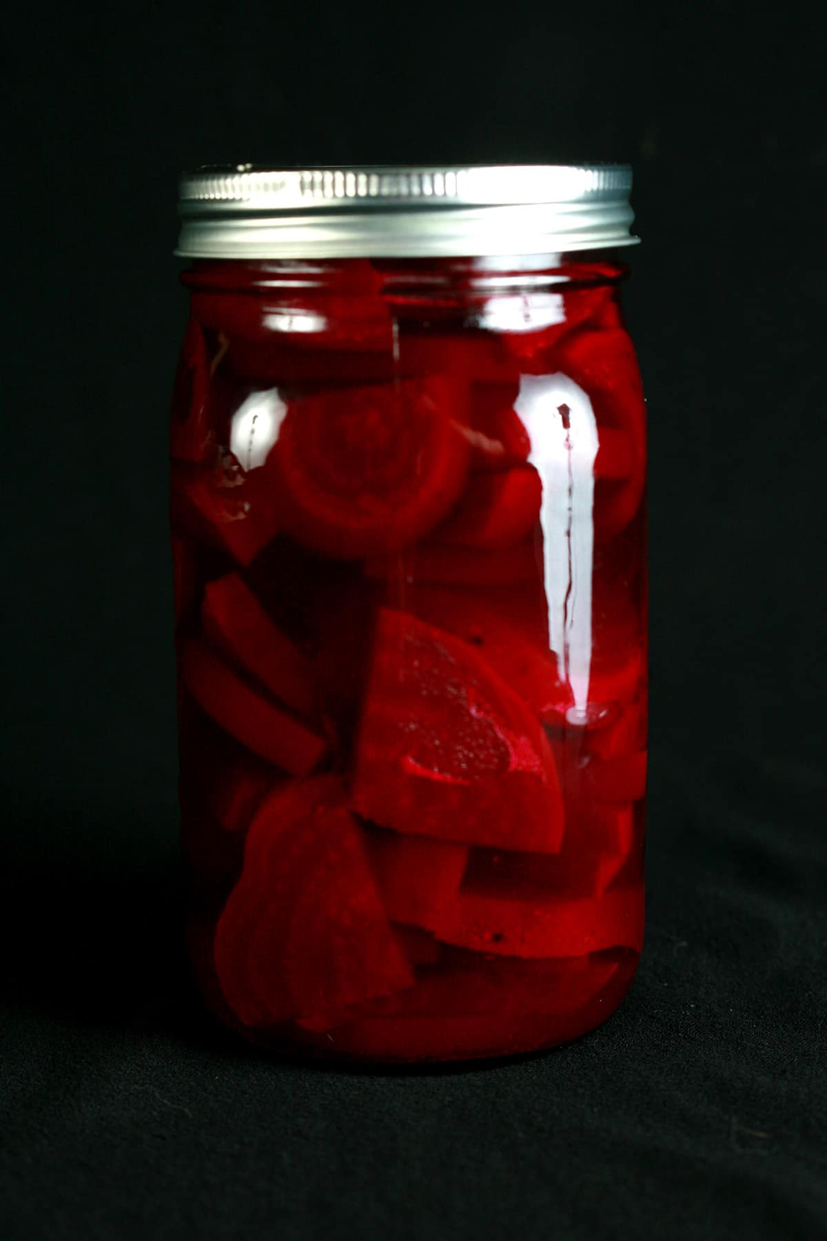 A large jar of homemade beet pickles.
