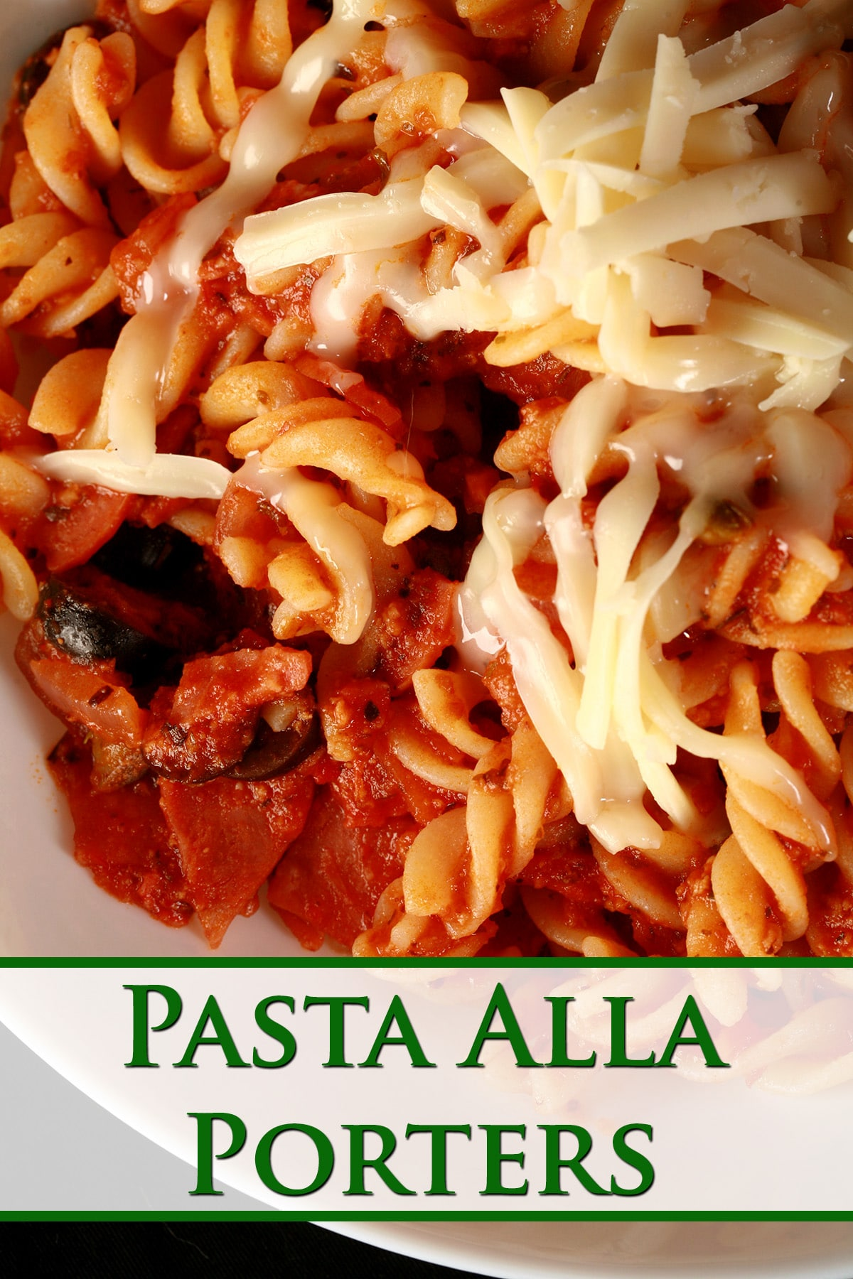 A bowl of pasta in red sauce, with bits of pepperoni and sliced black olives visible. There is shredded mozzarella on top - Pasta Alla Porters.