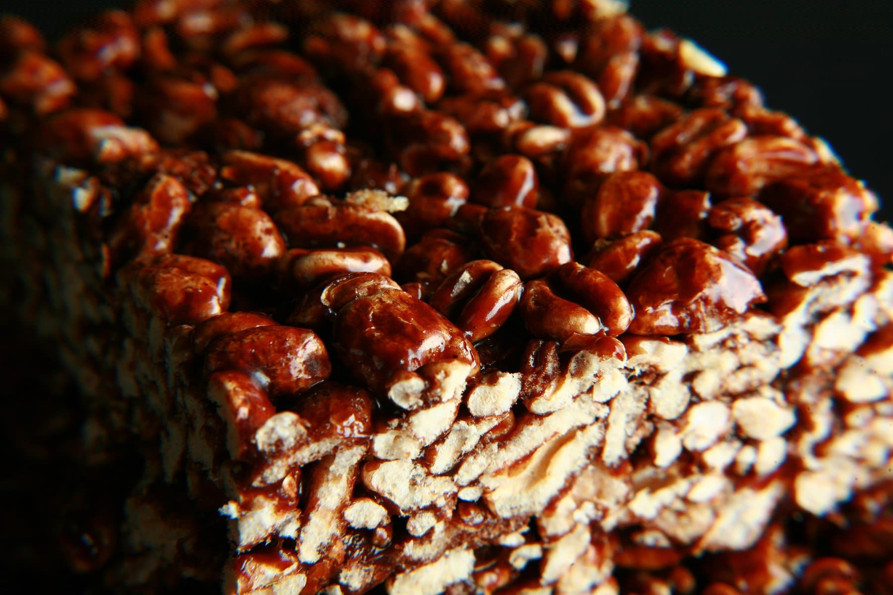 A small glass plate stacked with large pieces of puffed wheat bars.