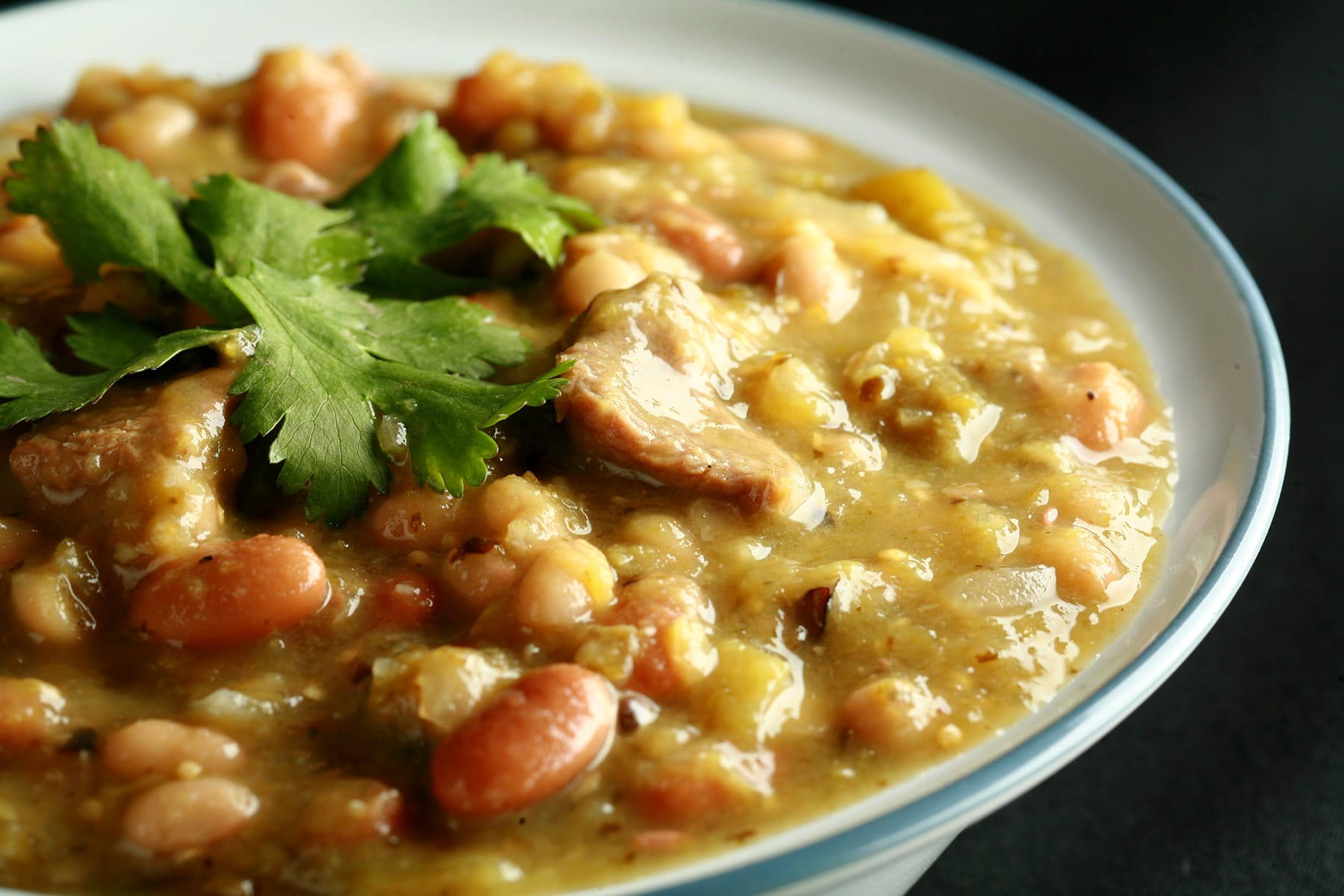 A close  up view of a bowl of roasted green chili.