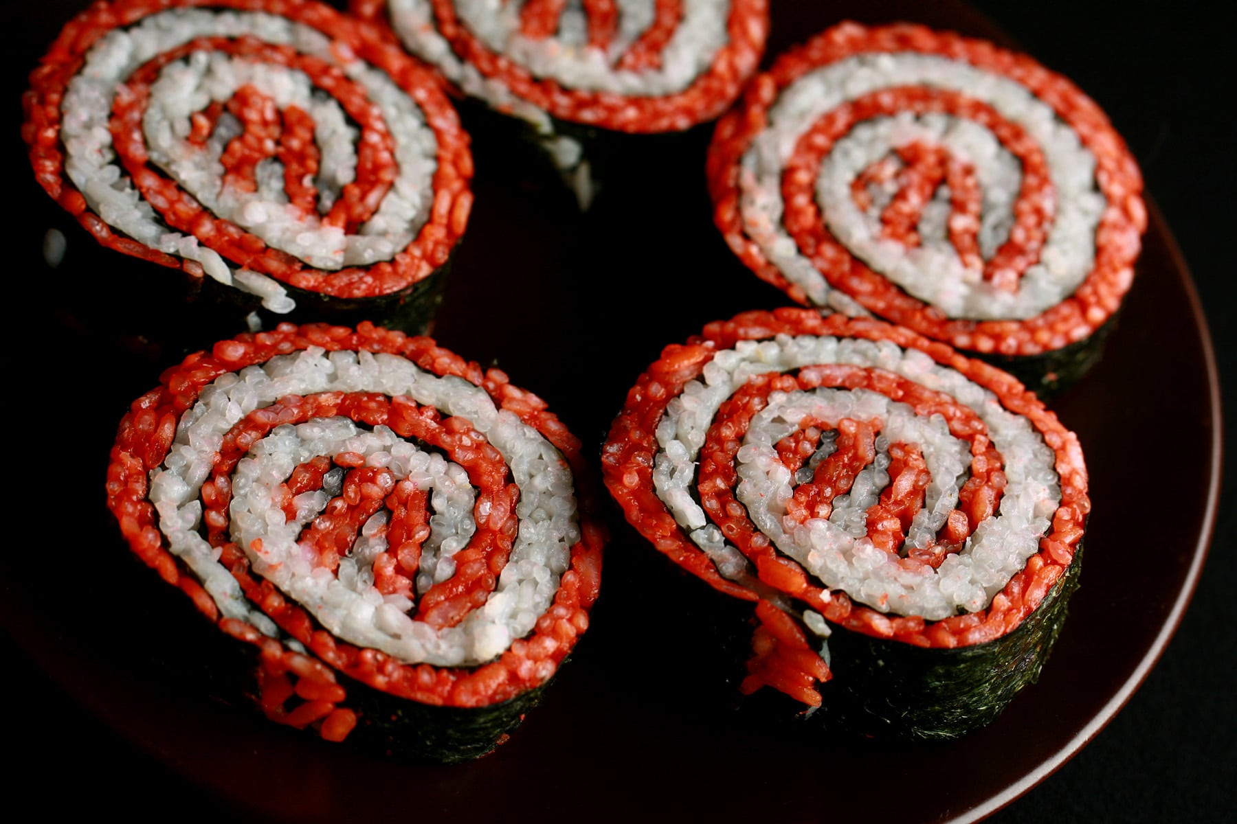 A close up view of a plate of sushi shaped to look like the Masterchef logo.