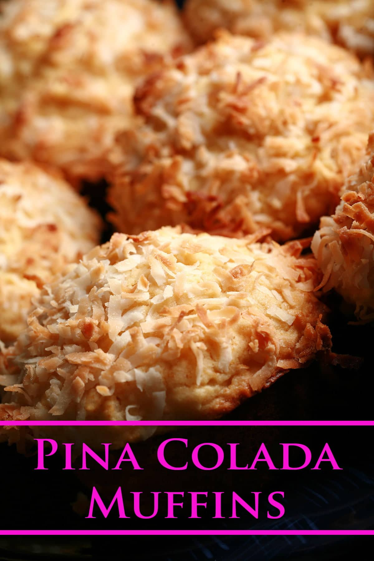 Several Pina Colada Muffins, tightly arranged. The tops of each are covered in toasted coconut.