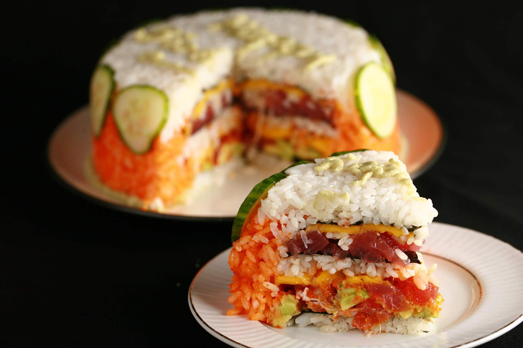 A small sushi cake. Layers of rice and fish in the form of a birthday cake.