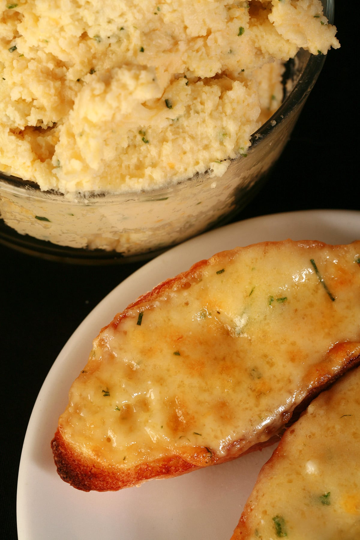 A plate of broiled garlic cheese bread made with fromage fort.
